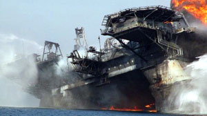 The Deepwater Horizon begins to list as it burns. The oi