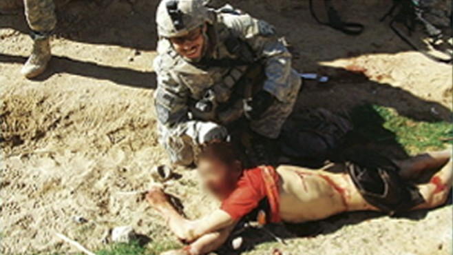 VIDEO: Newly-published photos show U.S. soldiers apparently posing over a victim.