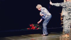 PHOTO: Woman lays down a rose