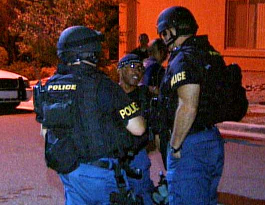 Photo: Behind the Scenes of a Kidnapping: Police try to rescue a victim in peril.