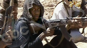 PHOTO A new video produced by al Qaeda in Yemen shows the accused underwear bomber Umar Farouk Abdulmutallab and others in his training class firing weapons at a desert camp.