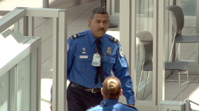 PHOTO: TSA agent Andy Ramirez is seen at a security checkpoint at Orlando International A
