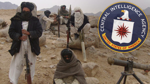 PHOTO Taliban fighters pose with weapons in an undisclosed location in Afghanistan in this October 30, 2009 file photo.