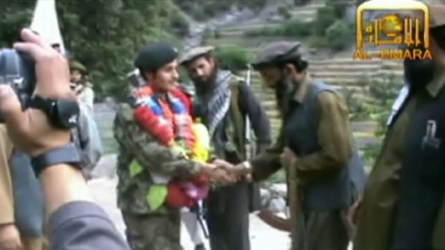 VIDEO: Taliban releases video of rogue ANA soldier as he's congratulated by Taliban commanders.