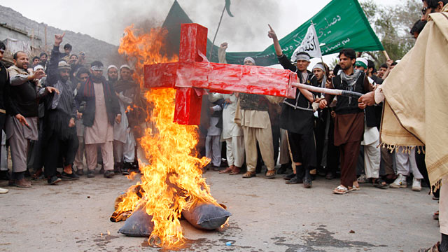 PHOTO: Afghans burn an effigy depicting the U.S. following the killing of civilians in Panjwai,  Kandahar by a U.S. soldier during a protest in Jalalabad, Afghanistan, March 13, 2012.