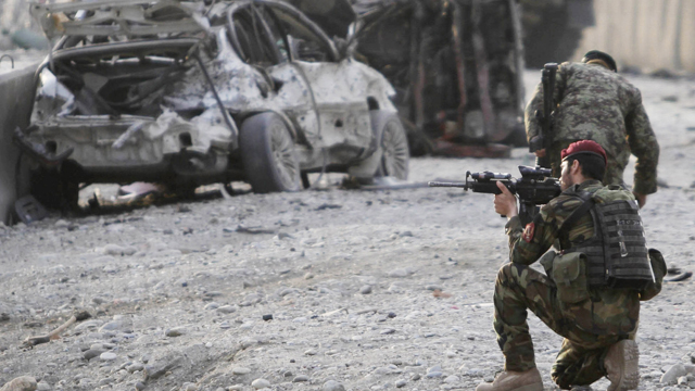 PHOTO: An Afghan soldier secures the scene of a suicide attack at the gate of an airport in Jalalabad, Nangarhar province east of Kabul, Afghanistan, Feb. 27, 2012.