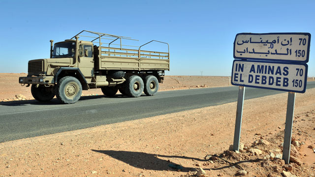 PHOTO: An Algerian military truck drives past a road sign indicating the city of Ain Amenas where hostages have been kidnapped by islamic militants at a gas plan, Jan. 18, 2013.