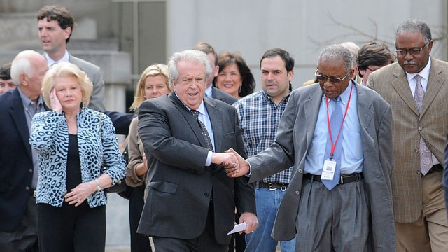 PHOTO: Casino owner Milton McGregor, center, shakes hands with attorney Fred Gray after McGregor and five other defendants were found not guilty on all counts in the gambling corruption trial at the Federal courthouse in Montgomery, Ala., March 7, 2012.