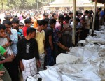 PHOTO: Bangladeshi people identify the bodies of their relatives who died in a fire at a garment factory in the Savar neighborhood in Dhaka, Bangladesh, Sunday Nov. 25, 2012.