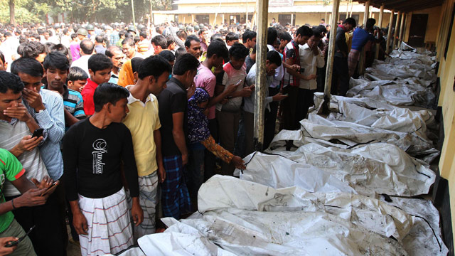 PHOTO: Bangladeshi people identify the bodies of their relatives who died in a fire at a garment factory in the Savar neighborhood in Dhaka, Bangladesh, Sun
