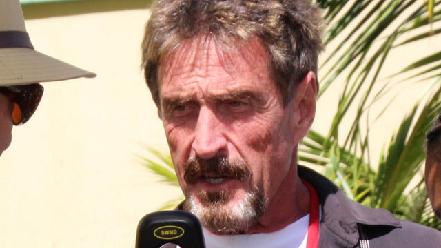 "PHOTO: John McAfee speaks at the official presentation of equipment ceremony at the San Pedro Police Station in Ambergris Caye, Belize, Nov. 8, 2012. McAfee has been identified as a ""person of interest"" in the killing of his neighbor, Gregory Viant Faull."