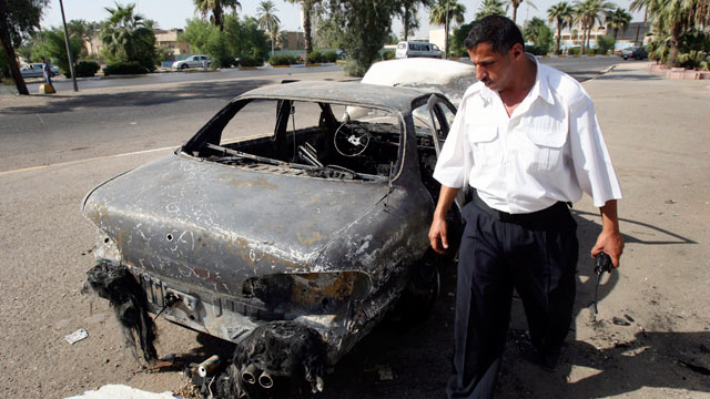 PHOTO: In this Sept. 25, 2007 file photo, an Iraqi traffic policeman inspects a car destroyed by a Blackwater security detail in al-Nisoor Square in Baghdad, Iraq.