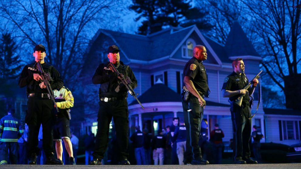 PHOTO: Police officers guard the entrance to Franklin street where there is an active crime scene search for the suspect in the Boston Marathon bombings, April 19, 2013, in Watertown, Mass.