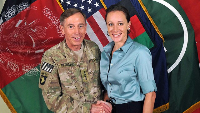 PHOTO: Davis Petraeus, left, shaking hands with Paula Broadwell, co-author of
