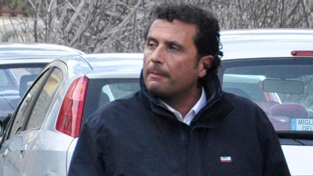 PHOTO: Francesco Schettino, the captain of the luxury cruiser Costa Concordia, which ran aground off Italy's Tuscan tiny island of Isola del Giglio, is taken into custody by Carabinieri in Porto Santo Stefano, Italy, Jan. 14, 2012.