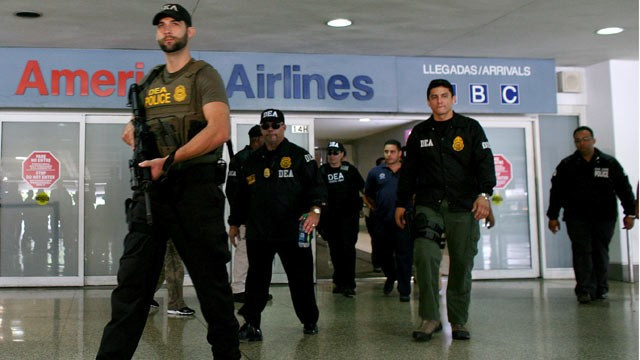 PHOTO: U.S. federal agents say they raided Puerto Rico's international airport and other areas early on June 6, 2012, arresting at least 33 people suspected of smuggling millions of dollars' worth of drugs aboard commercial flights.