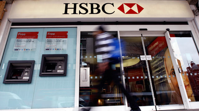PHOTO: This is a Feb. 27, 2012 file photo of a pedestrian passes a branch of HSBC bank in London; HSBC