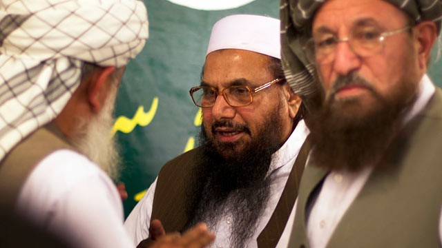 PHOTO: Hafiz Mohammad Saeed, center, talks with religious leaders prior to his news conference in Rawalpindi, Pakistan, April 4, 2012.