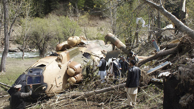 PHOTO: Afghan officials investigate the scene May 11, 2011, after an Afghan Defense Ministry helicopter crashed when it hit a tree about 300 yards from the building housing governor Jamalludin Badar in the northeastern province of Nuristan, Afghanistan.