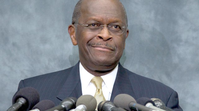 republican presidential candidate herman cain pauses as he speaks at