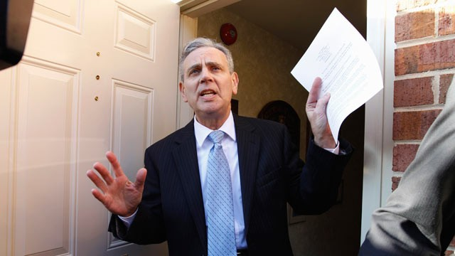 PHOTO: Joel Bennett, an attorney for a woman who accused Herman Cain of sexual harassment while both worked at the National Restaurant Association, hands out statements during a news conference outside his office, Washington, Nov. 4,  2011.
