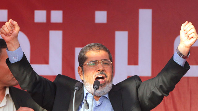 PHOTO: Egypts President-elect Mohammed Morsi talks to his supporters at Tahrir Square, the focal point of Egyptian uprising, during his speech in Cairo, Egypt, June 29, 2012.