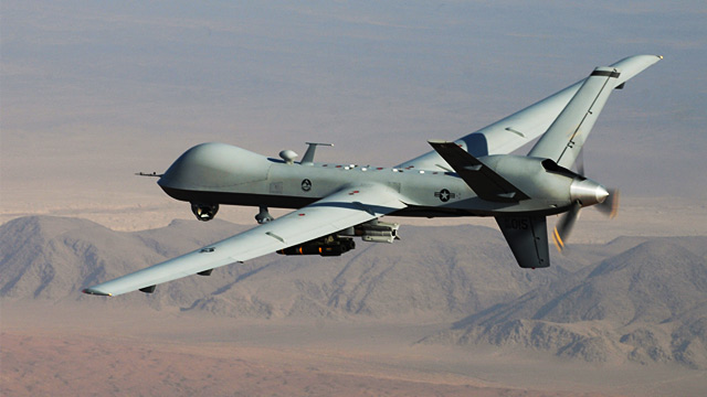 An MQ-9 Reaper, armed with GBU-12 Paveway II laser guided munitions and AGM-114 Hellfire missiles, is piloted by Col. Lex Turner during a combat mission over southern Afghanistan, in this undated photo.