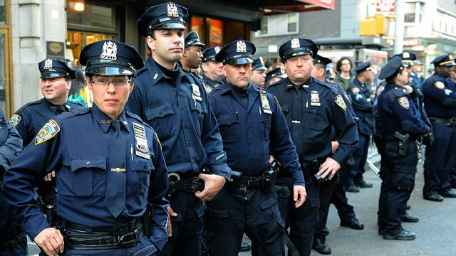 PHOTO: Police keep watch as protesters stage a protest in New York, May 1, 2012.