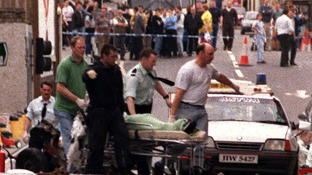PHOTO: A body is removed from the scene shortly after a car bomb exploded in Omagh Co Tyrone, Northern Ireland, Aug. 15, 1998.