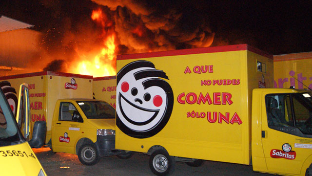 PHOTO:In this photo taken May 25, 2012, flames rise from a warehouse of the Mexican potato-chip company Sabritas, in Lazaro Cardenas, Mexico which was attacked by unidentified gunmen in what has been described as the most violent and concerted attack on a