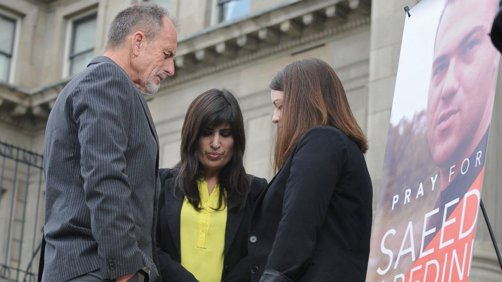 PHOTO: Calvary Chapel of Boise Pastor Bob Caldwell, left, prays with Naghmeh Abedini, center, and Tiffany Barrans, with the American Center for Law and Justice Thursday, Sept. 26, 2013 on the steps of the Capitol building in Boise, Idaho.