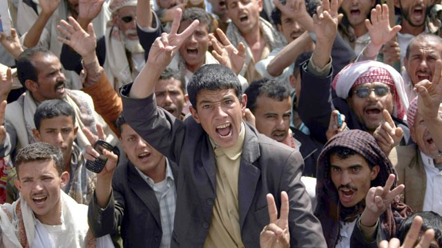 PHOTO: Flashing the V-sign for victory, anti-government protesters shout slogans during a rally to demand the trial for Yemen's outgoing President Ali Abdullah Saleh in Sanaa, Jan. 16, 2012.