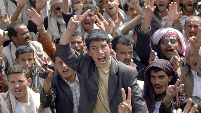 PHOTO: Flashing the V-sign for victory, anti-government protesters shout slogans during a rally to demand the trial for Yemens outgoing President Ali Abdullah Saleh in Sanaa, Jan. 16, 2012.