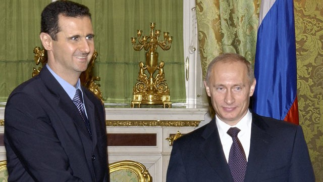 PHOTO: Russian President Vladimir Putin (R) shakes hands with his Syrian counterpart Bashar al-Assad during their meeting in Moscow, Jan. 25, 2005.