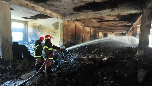 PHOTO: Bangladeshi fire-men extinguish a fire in the nine-story Tazreen Fashion plant in Savar, north of Dhaka, Nov. 25, 2012.