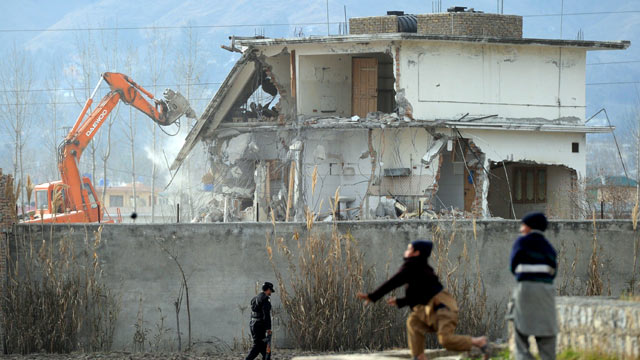 PHOTO: Young Pakistani boys play near demolition works on the compound where Al-Qaeda chief Osama bin Laden was slain last year in the northwestern town of Abbottabad, Feb. 26, 2012.
