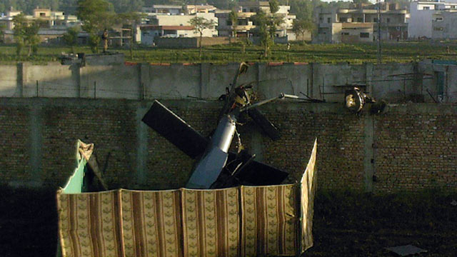 PHOTO: A crashed military helicopter is seen near the hideout of Al-Qaeda leader Osama bin Laden after a ground operation by US Special Forces in Abbottabad, May 2, 2011.