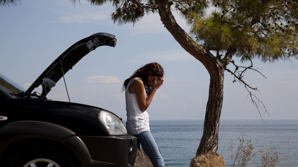 PHOTO: A frustrated motorist sits with her car in an undated stock photo.