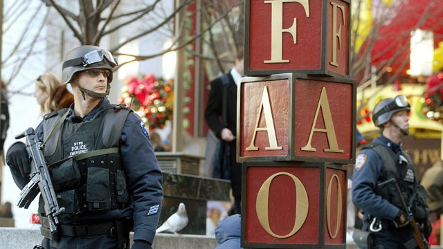 PHOTO: New York Police Department Emergency Service Unit officers stand guard outside the FAO Schwarz store, New York City. Dec. 12, 2002.