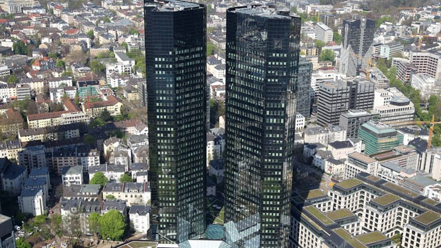 PHOTO: The two towers of the headquarters of German bank Deutsche Bank are seen in Frankfurt on Main, western Germany, April 7, 2011.