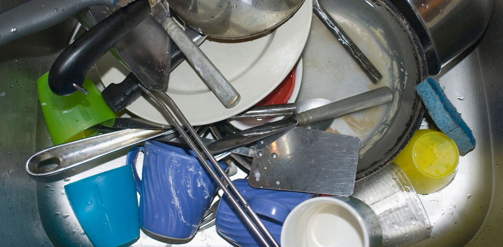 PHOTO: Dirty dishes fill the sink.