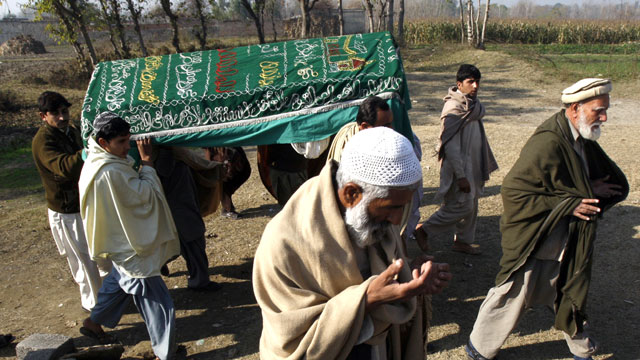 PHOTO: Mourners carry a coffin of a Pakistani charity worker, Jan. 2, 2013, who was killed with other colleagues during an attack by gunmen in Swabi. Sev