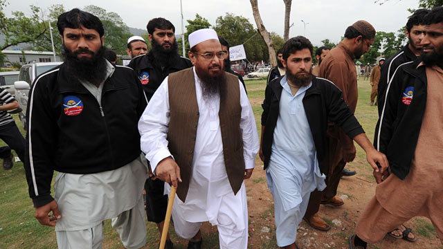PHOTO: Chief of the Pakistan's outlawed Islamic hardliner Jamaat ud Dawa and Hafiz Mohammad Saeed, center, arrives to attend funeral prayers.