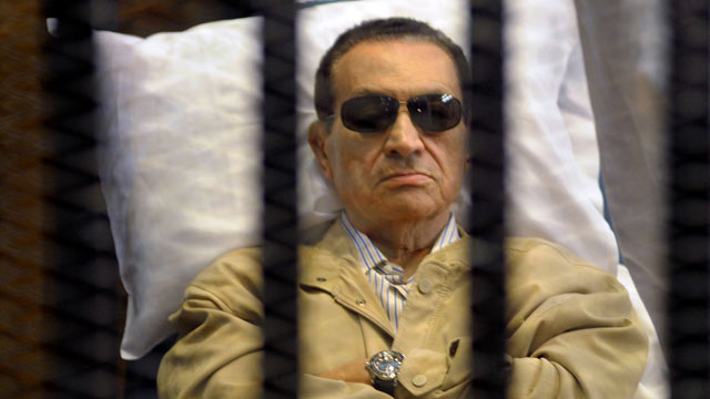 PHOTO: Ousted Egyptian president Hosni Mubarak sits inside a cage in a courtroom during his verdict hearing in Cairo, June 2, 2012. A judge sentenced Mubarak to life in prison after convicting him of involvement in the murder of protesters during the upri