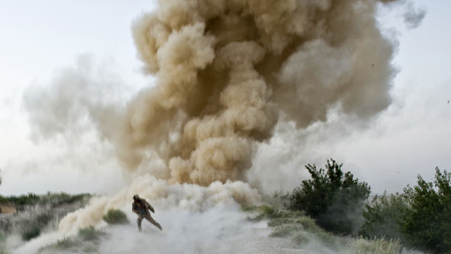 PHOTO: A US Marine runs to safety moments after an IED blast in Garmsir district of Helmand Province in Afghanistan.