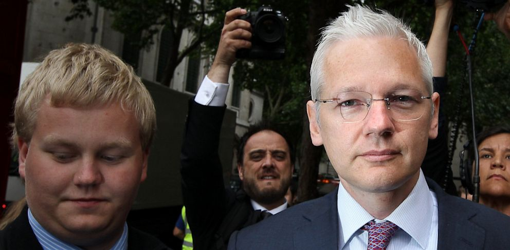 PHOTO: Sigurdur Thordarson, left, walks with WikiLeaks website founder Julian Assange, right, as he arrives at The High Court on July 13, 2011 in London, England.