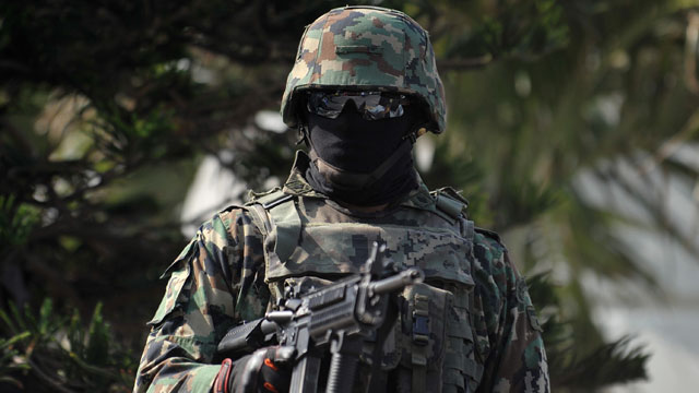 PHOTO: A Mexican marines stand stand guard in streets of Veracruz Stat