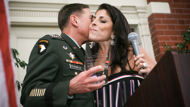 PHOTO: General David Petraeus kisses Jill Kelley after accepting community service award presented at Kelleys home during the su