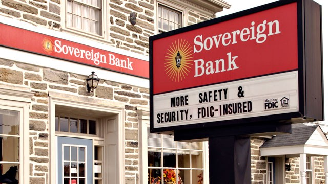 PHOTO: A sign for a Sovereign Bank branch stands in Oreland, Pennsylvania in this October 13, 2008 file photo.