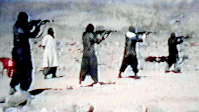 PHOTO: Members of Al-Qaeda are seen training with AK-47 sub-machine-guns in a video tape, June 19, 2001.